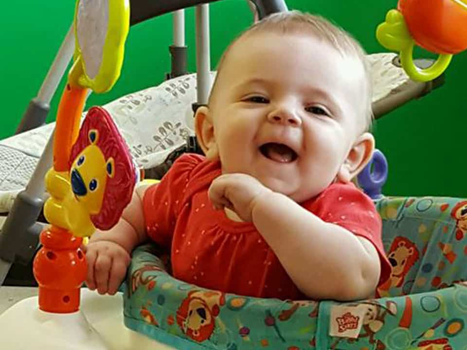 Smiling baby at Kid Works Creative Learning Center in Mount Healthy, OH